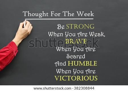 Inspirational Thought For The Day message of  Be Strong When You Are Weak, Brave When You Are Scared and Humble When You Are Victorious written on a School Blackboard by the teacher #382308844
