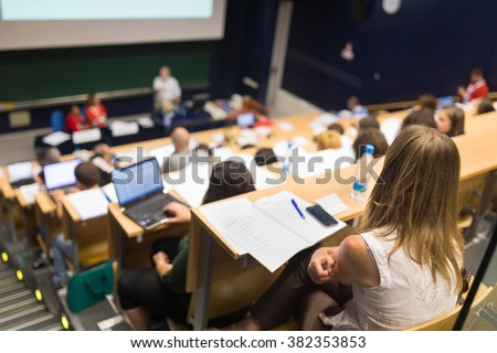 Audience in the lecture hall. Royalty-Free Stock Photo #382353853