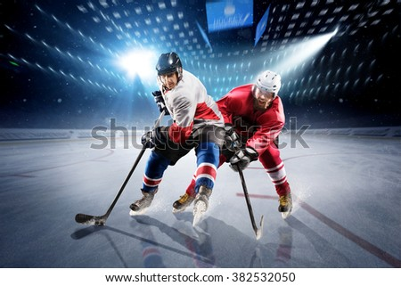 Hockey players shoots the puck and attacks #382532050