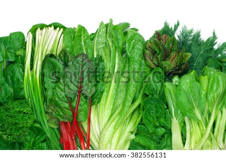 Various green leafy vegetables in row on white background. Top view point. #382556131