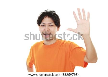 Smiling Asian man #382597954