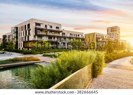 Residential building in the public green park during sunrise Royalty-Free Stock Photo #382666645