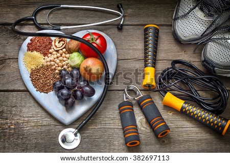 Healthy lifestyle concept with diet and fitness Royalty-Free Stock Photo #382697113