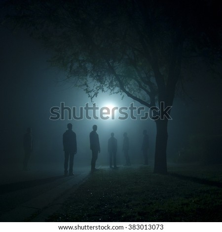 Duplicated photo of myself standing under a streetlight on a foggy night #383013073