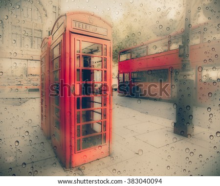 Street scene in London with iconic red phone booth and double decker bus.  This image has a rainy texture overlay.