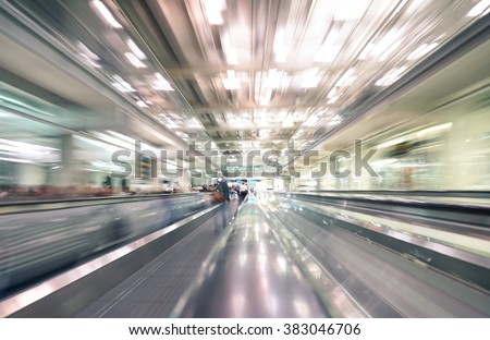 Radial zoom defocused treadmills with motion blur -  Modern international airport - Concept of travel around the world and wanderlust feelings