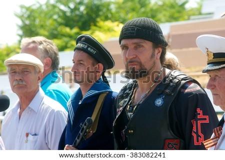 """SEVASTOPOL, UKRAINE - AUGUST 18, 2013: Organizer show """"Surgeon"""", International Moto Bike Show, August 18, 2012 in Sevastopol, Ukraine #383082241"""