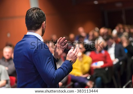 Public speaker giving talk at Business Event. Royalty-Free Stock Photo #383113444
