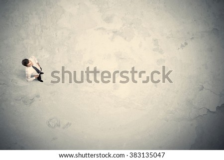 Business man from top standing with copy space desert background #383135047
