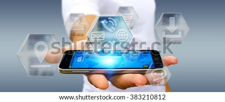 Young man holding mobile phone with application icons interface in his hand #383210812