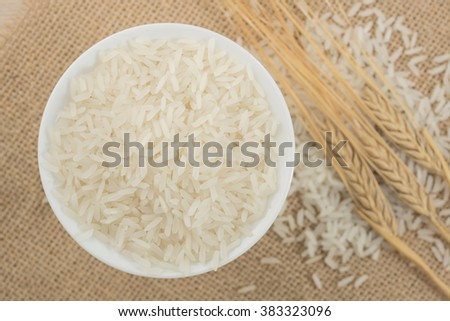Rice in white bowl on wood background. #383323096