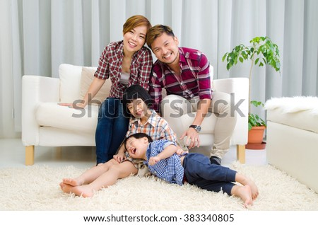 Asian family having fun in the living room #383340805
