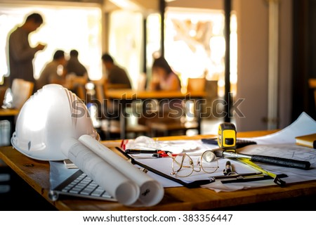 Architectural Office desk background construction project ideas concept, With drawing equipment with mining light Royalty-Free Stock Photo #383356447