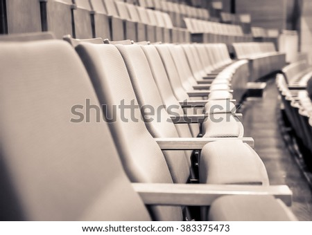 Duo tone color image/ Close up and selective focus of Empty rows of armchairs in hall  #383375473