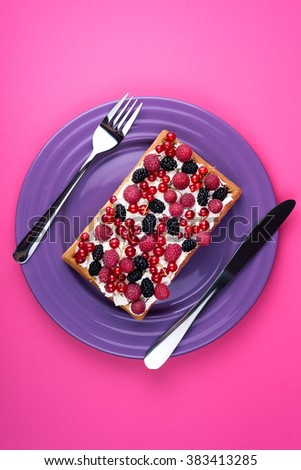 Viennese waffles cake on plate with knife and fork on pink background. Top view  #383413285