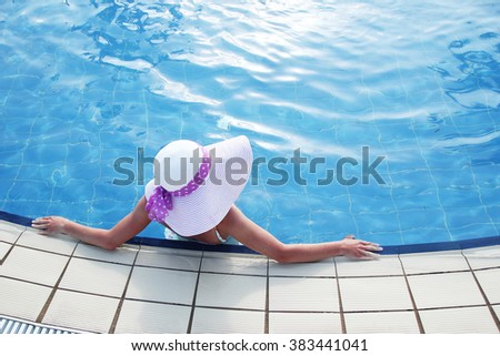 a girl with a hat in the water basin #383441041