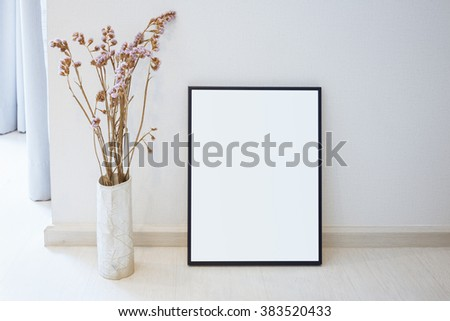 Mock up black photo frame on floor Home interior decoration with flower  #383520433