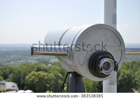 View of the city of Krakow (Poland) and a coin operated telescope on bright sunny day #383538385