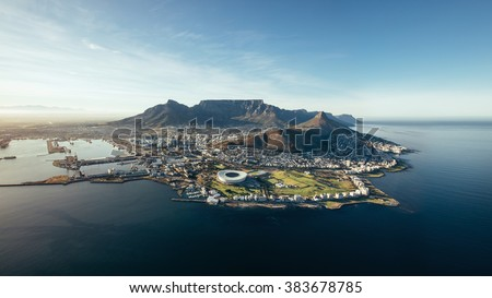Aerial coastal view of Cape Town. View of cape town city with table mountain, cape town harbour, lion's head and devil's peak, South Africa. Royalty-Free Stock Photo #383678785