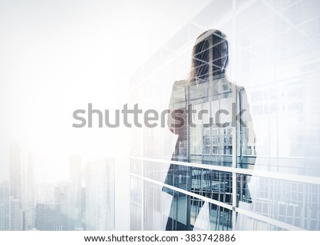 Photo of businesswoman. Double exposure, city on the background. Blurred background, horizontal