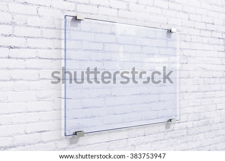 Blank glassy sighnboard on white brick wall, mock up