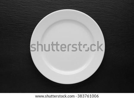plate, knife and fork on table background Royalty-Free Stock Photo #383761006
