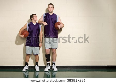 Tall and short basketball players Royalty-Free Stock Photo #383817286