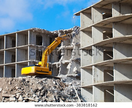 Building demolition with hydraulic excavator Royalty-Free Stock Photo #383818162