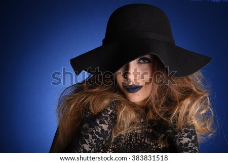 Beautiful sexy model showing fashion poses, Cute lady in the blue dress staying on the blue background, pretty nice girl smiling, blue style make up, blond woman portraiture #383831518