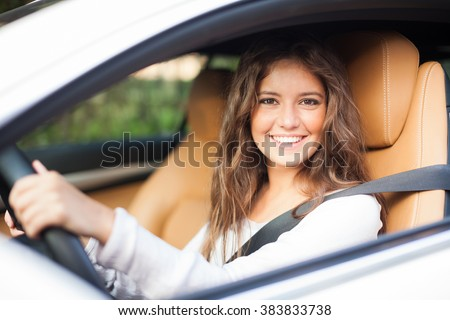 Young woman driving her car #383833738