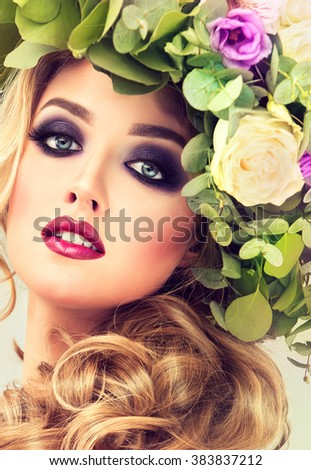Girl spring . Beautiful model with flower wreath on his head . Makeup smoky eyes . Summer girl with trendy makeup . #383837212