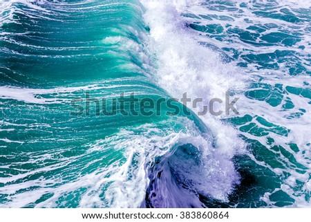 Ocean splashing waves Royalty-Free Stock Photo #383860864