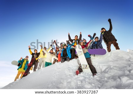 Group of tourists having fun at ski and snowboard resort Sheregesh. Siberia, Russia #383927287