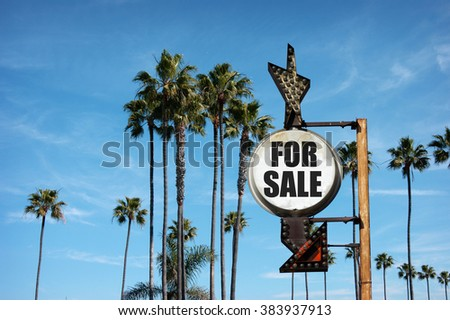 aged and worn vintage photo of for sale sign with palm trees  #383937913
