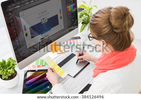 Graphic designer at work. Color swatch samples. Royalty-Free Stock Photo #384126496