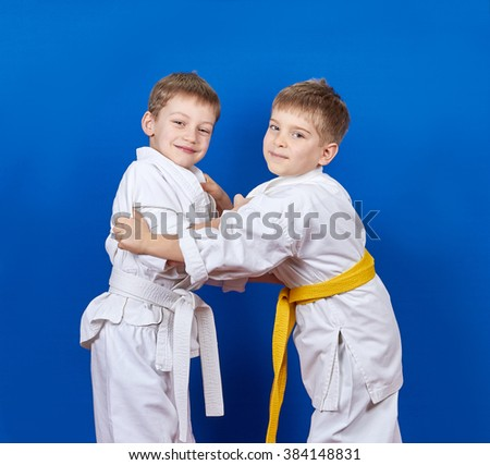 Two athletes train judo techniques #384148831
