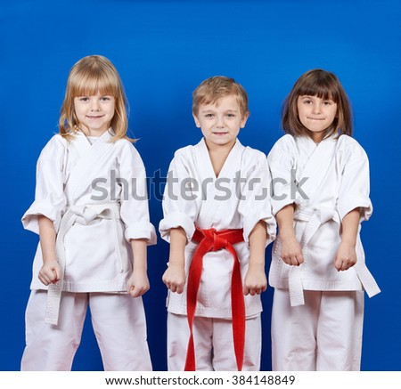 Boy and two girls are standing in the rack karate #384148849