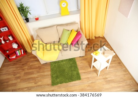 Modern living room interior with beige sofa and small green carpet #384176569