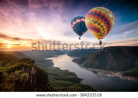 Colorful hot air balloons flying over on Mae Ping National Park at sunrise