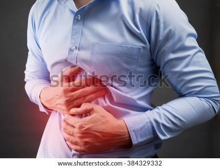 Businessman in blur shirt feel stomachache because painful disease feeling unwell. health care concept #384329332