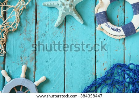 top view nautical concept with nautical life style objects  Royalty-Free Stock Photo #384358447