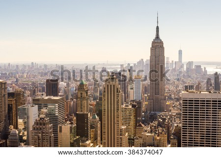 NEW YORK, USA - OCT 6, 2015: Empire State Building from the Rockfeller Center (Top of the Rock). One of the popular observation points of New York #384374047