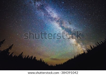 Milky Way galaxy rises over the forest in summer time