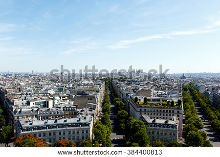Color DSLR stock image of boulevards and neighborhood in Paris, France, as seen from top of Arc de Triomphe. Horizontal with copy space for text #384400813
