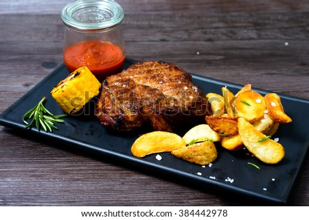 juicy pork Steak with potatoes and vegetables #384442978