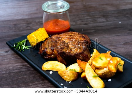 juicy pork Steak with potatoes and vegetables #384443014