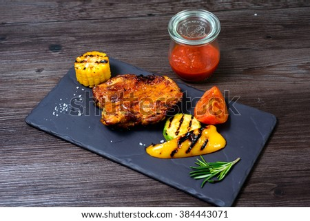 juicy grilled chicken with vegetables on a basalt slab #384443071