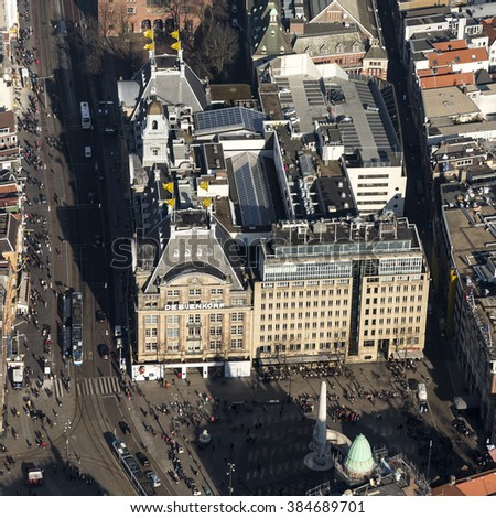 17 February 2016, Amsterdam. Close up aerial view of department store BIJENKORF at the dam square. It's an historical building inside the GRACHTENGORDEL, which is on the UNESCO world heritage list. #384689701