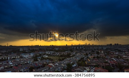 Stormy and rainy sunset in downtown Kuala Lumpur  #384756895