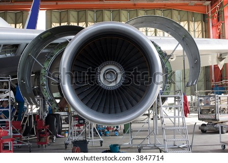 opened aircraft engine in the hangar #3847714